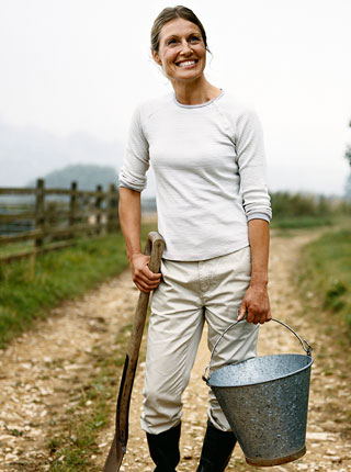 Rural woman holding a steel bucket